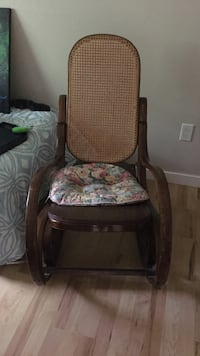 brown wooden frame floral cushioned rocking chair Colwood, V9C 2H9