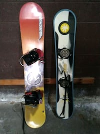 two assorted-color of snowboards