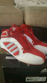 pair of red-and-white Adidas basketball shoes Rochester