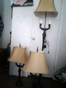 Three metal lamps with golden color shades