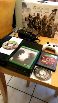 Xbox One console with controller and game cases Fresno