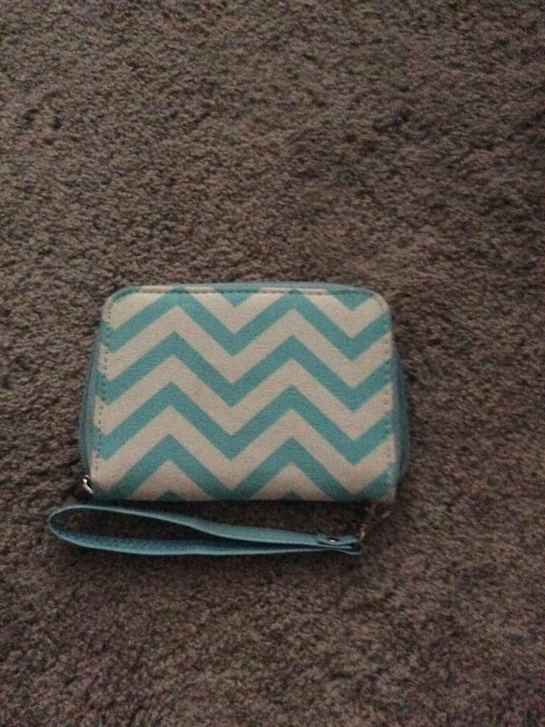 White and teal chevron wristlet