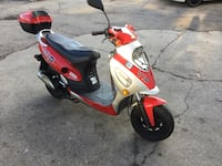 red and white motor scooter 678 mi