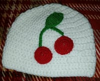 red, green, and white knitted beanie Phenix City, 36867