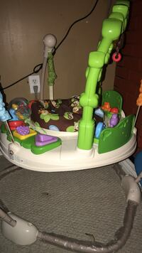 white, green, and brown jumperoo