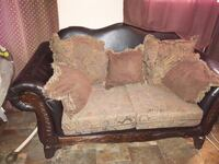 brown fabric floral padded brown wooden loveseat