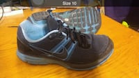 pair of black-and-blue Nike running shoes Surrey, V3R 3S9