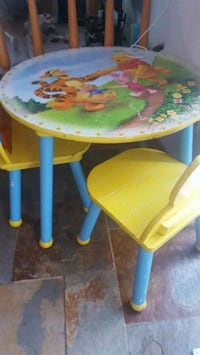 round yellow and blue wooden table with two chairs Calgary, T3K 5E9