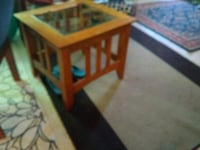 brown wooden table with black metal base Houston, 77007