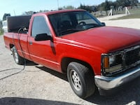 red single cab pickup truck