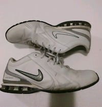 pair of white-and-gray Nike athletic shoes Mission, 66202