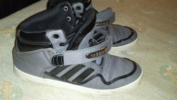 pair of black-and-white Adidas strap-on shoes