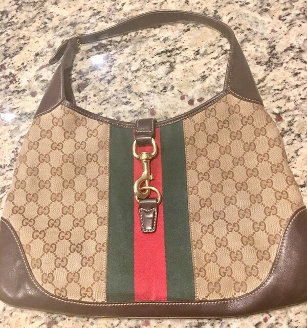 e6a035e80415 Used monogrammed brown Gucci leather backpack for sale in Dallas ...