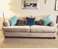 Brown fabric 2-seat sofa, with pillows if interested