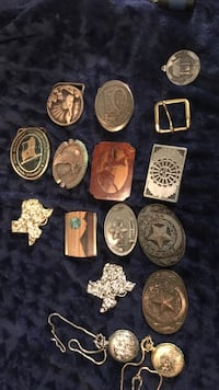 assorted belt buckles and pendants