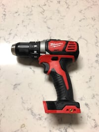 Black and red milwaukee cordless impact wrench