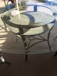 round glass top table with black metal base El Paso, 79912