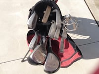 black and red golf bag with golf clubs Windsor, N8T