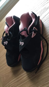 pair of black-and-pink Nike basketball shoes