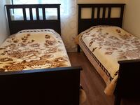 two black wooden twin beds Surrey, V3R 5X9