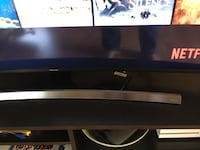 black flat screen TV with remote Burnaby, V5H 4E8