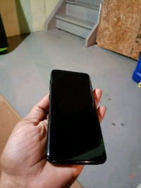 black Android smartphone with black case 528 km