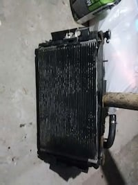 Dodge Caravan radiator with fans 284 mi