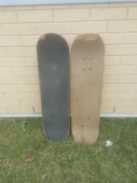 brown and gray skateboards