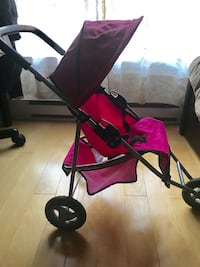 baby's black and pink stroller Montreal, H1Y 0A8