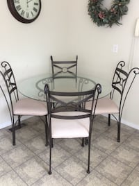 round glass top table with four chairs dining set Toronto, M9P 1T7