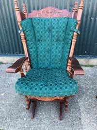 green and brown wooden framed glider chair South Bend, 46628