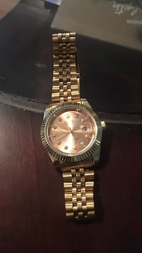 round gold Rolex analog watch with link bracelet St Catharines, L2S 3W8