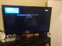 Black flat screen tv with remote Long Beach, 11561