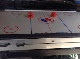White and silver air hockey table