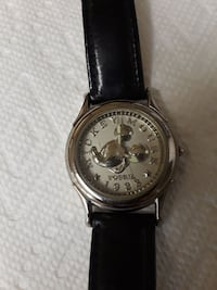 round silver-colored analog watch with black leather band