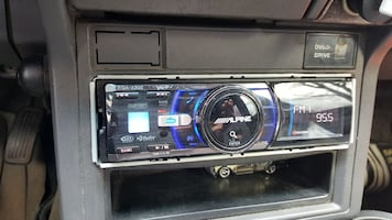 black and blue Alpine car stereo
