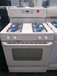 Old white gas stove GE Bowie, 20715