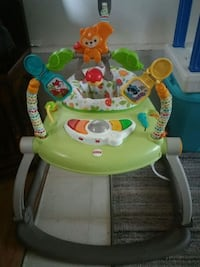 baby's green and white activity walker