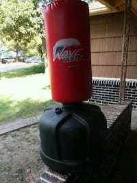 red and black Wave Master free standing heavy bag Houston, 77043