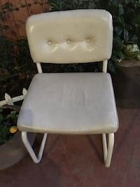 white leather padded rolling chair