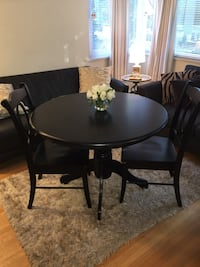 Modern black dining table w/ 4 chairs. Chairs and base is solid wood Vancouver, V6E 1H6