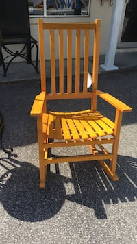 brown wooden rocking chair with table