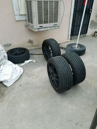 two black vehicle wheels and tires 2216 mi