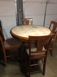 round brown wooden table with four chairs dining set Bowie, 20715