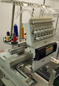 Commercial embroidery machine 15 needles 1 head. This machine has only about 10 hours of use on it. Comes with all accessories seen in pic. Moving must sell. Pick up only
