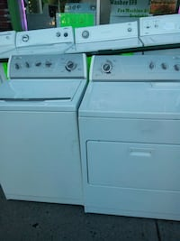 white top-load clothes washer and front-load dryer