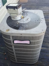 white and red Goodman air condenser