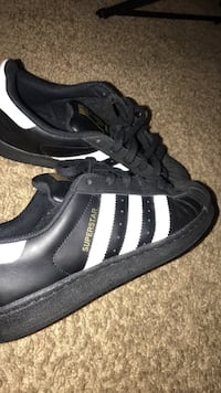 black-and-white Adidas Superstar shoes