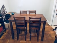 Bar height table. Includes 8 chairs and a leaf which makes this table square shaped Toronto, M4T