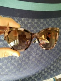 brown and black framed sunglasses Toronto, M5G 0A9